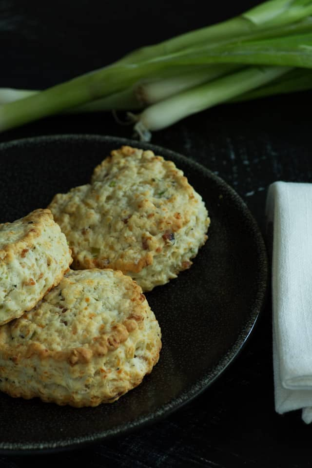 Bacon Gruyere and Green Onion Scones on a black plate