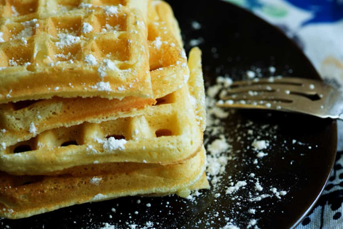 Waffles with powdered sugar on top.