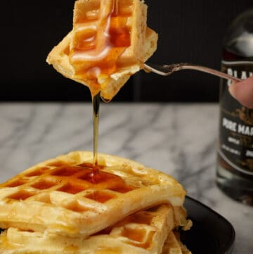 Syrup dripping off a bite of waffle.