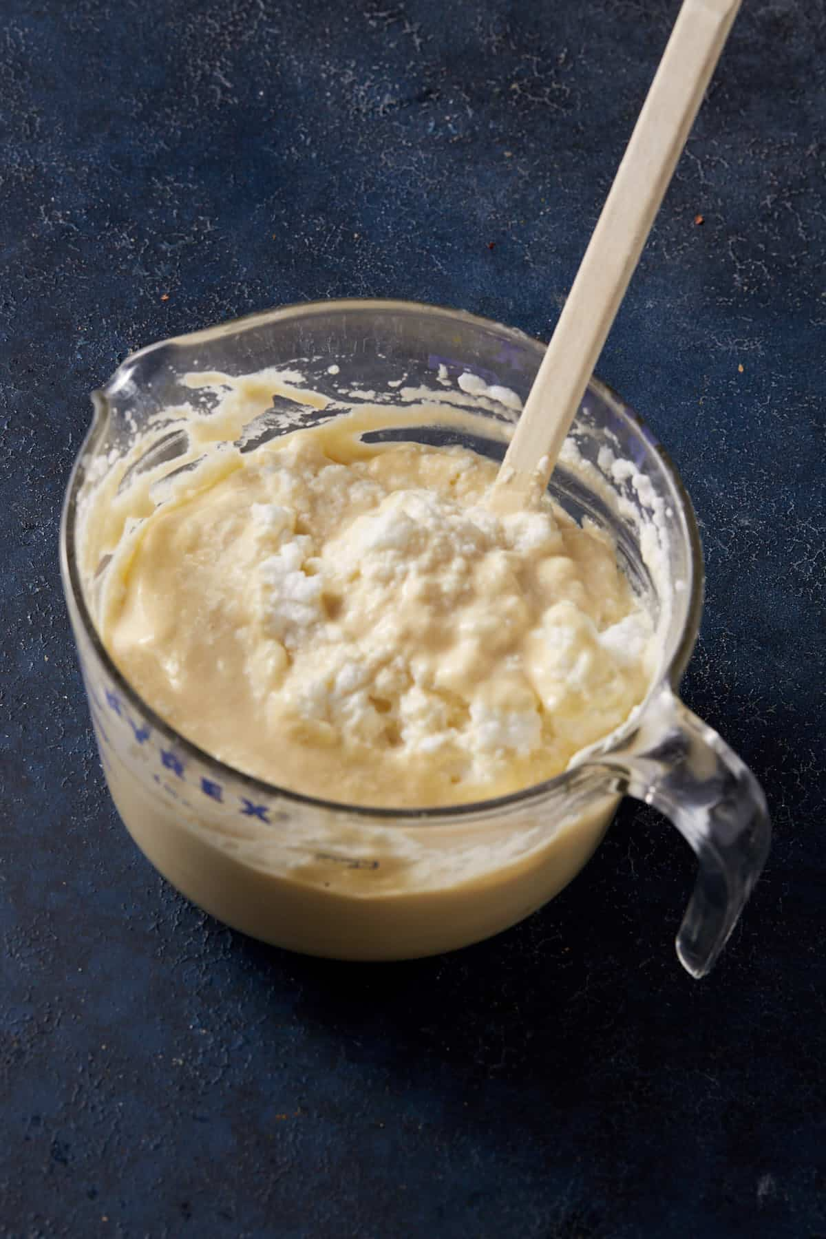 A stack of fluffy waffles with butter on top
