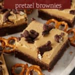 A platter of cut brownies with peanut butter frosting