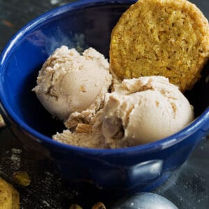 Pistachio shortbread cookies in a bowl with ice creeam