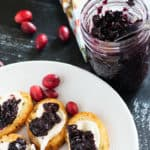 A dish of crostini with Cabernet Cranberry and Blueberry Sauce