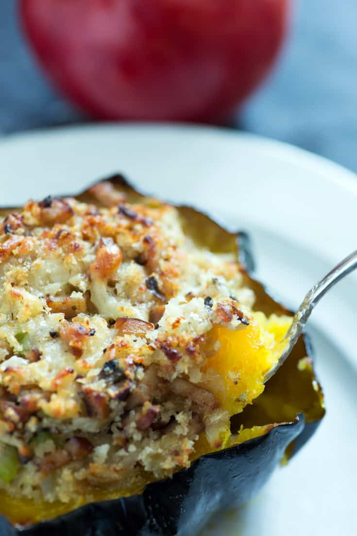 Baked Acorn Squash stuffed with spoon and apple