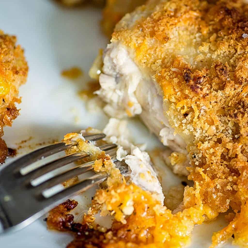 A bite of baked Ritz cracker chicken