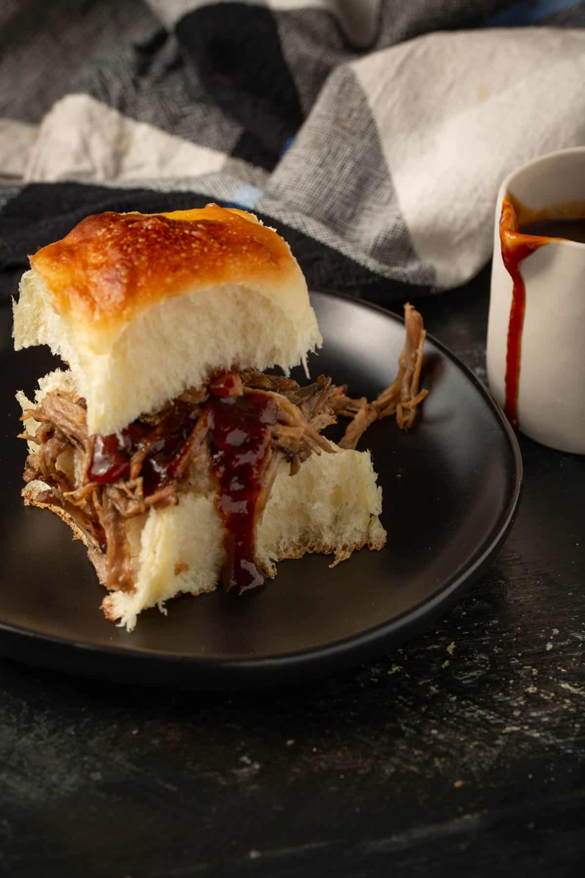 Pulled pork on a challah roll with barbecue sauce.