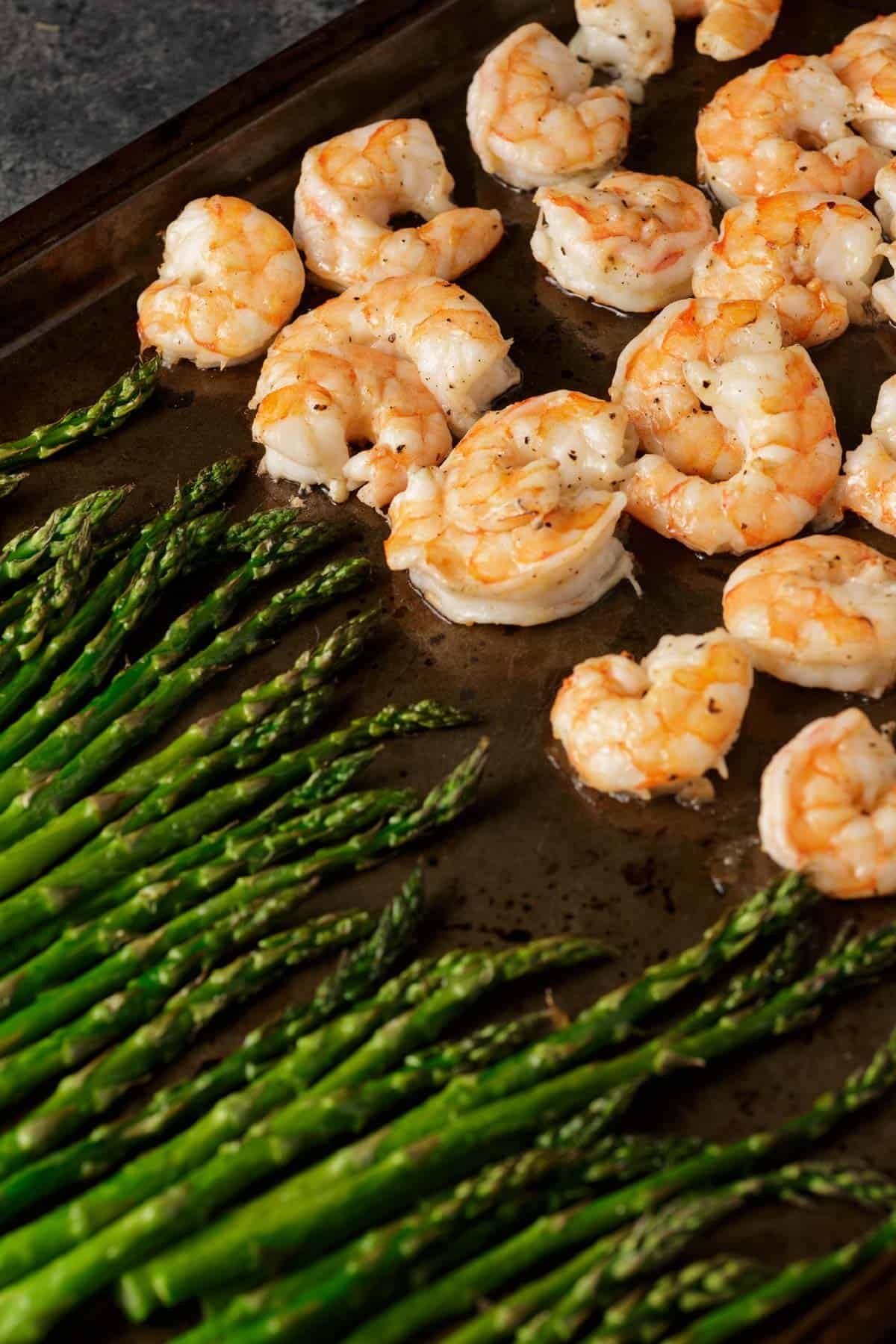 roasted shrimp on a sheet pan with asparagus