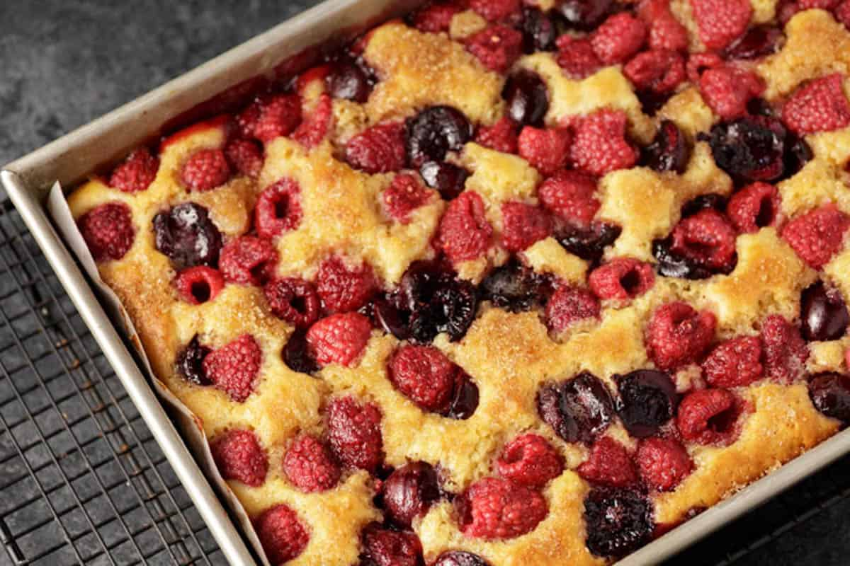 A pan of baked cherry coffee cake without icing.