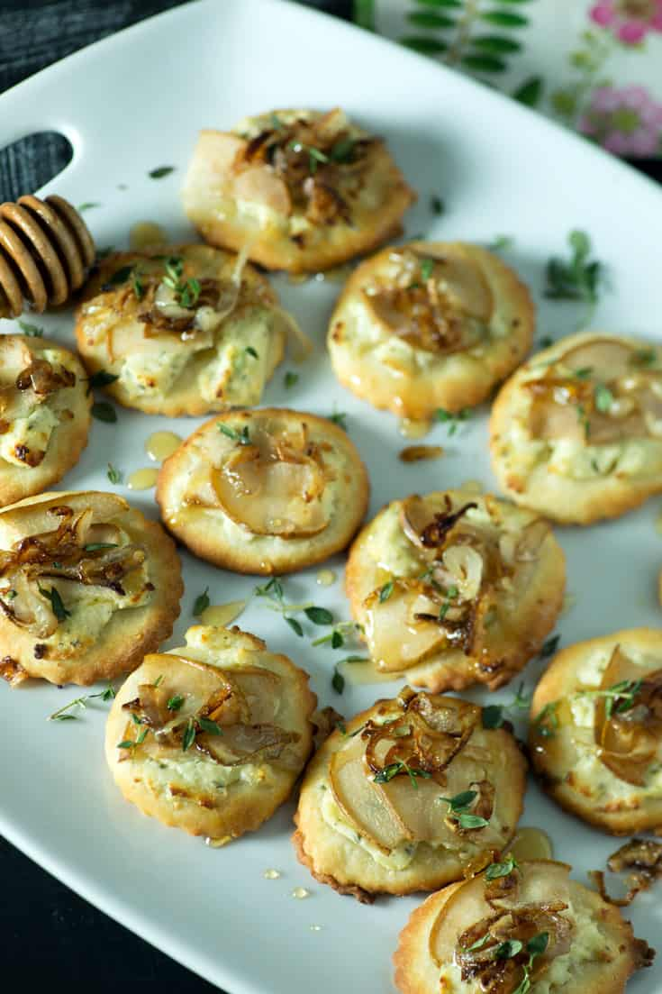 Close-up of Pear mini pizzas with caramelized shallots