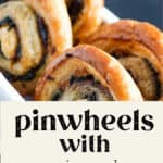 Pinwheels with Spinach lined up in a dish.