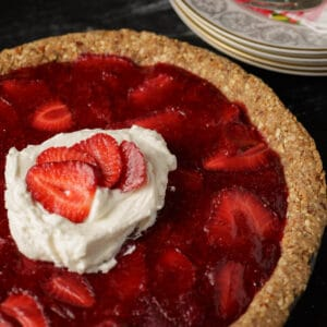 Once you've tried a Southern Strawberry Icebox Pie, you'll be hooked. This old fashioned pie with fresh strawberries is a classic. Both cooked and fresh berries are combined for a pie bursting with flavor.