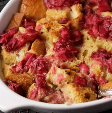 A spoonful of rhubarb bread pudding in a baking dish