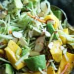 Close-up of Mango Avocado Broccoli Slaw in bowl