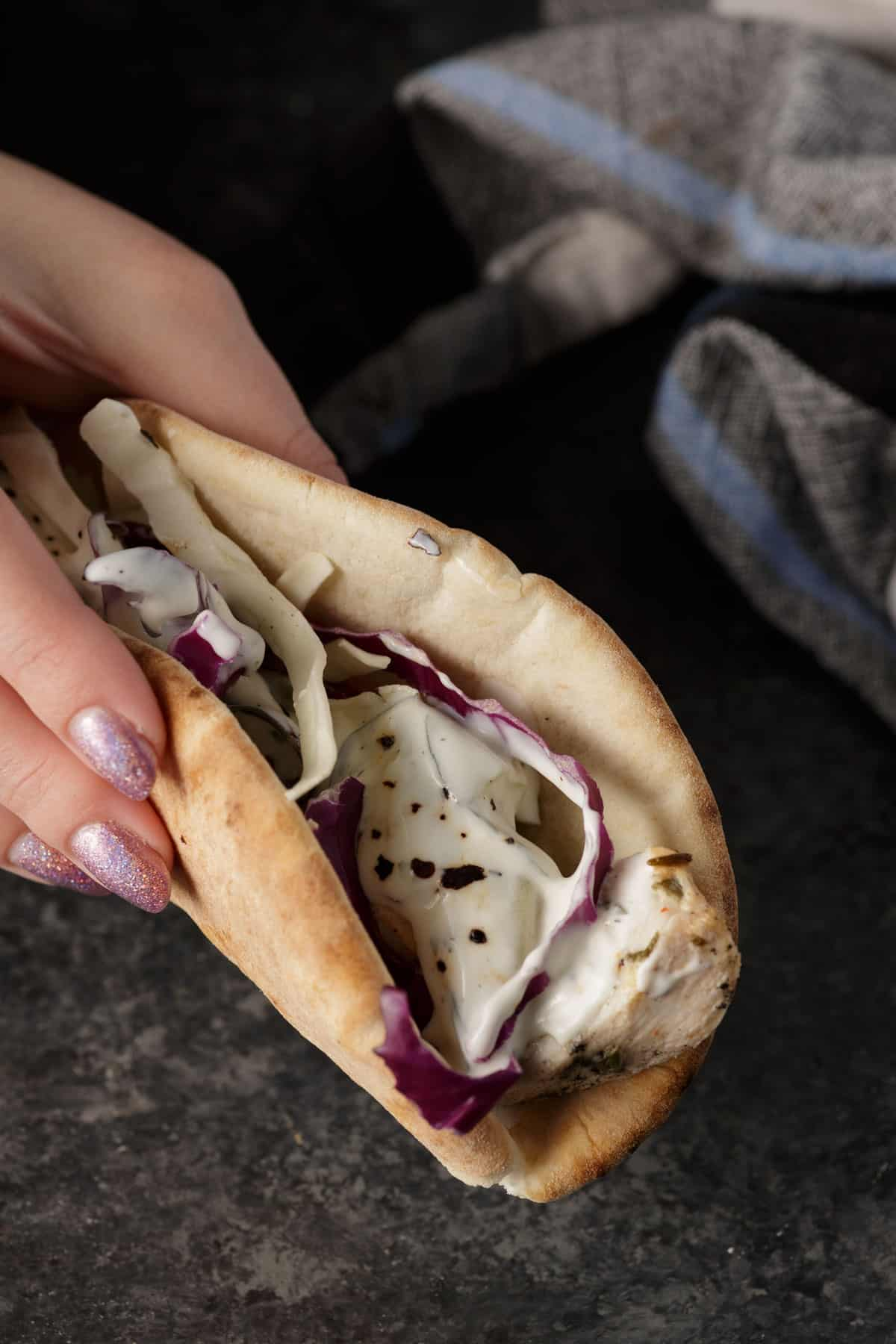 A pita stuffed with grilled ranch chicken
