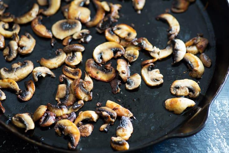 A skillet of browned mushrooms