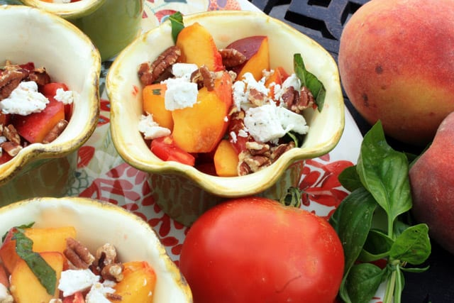 Peach and Tomato Salad in dish with peaches and tomatoes on side