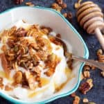 A bowl of yogurt with spicy granola on top