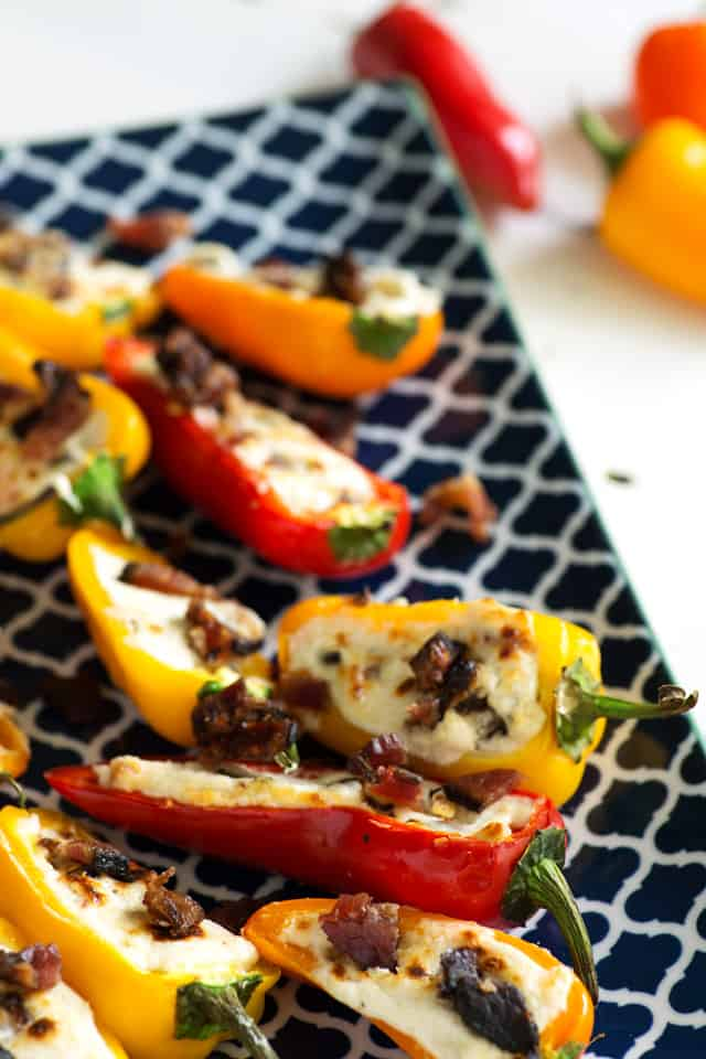Baby bell peppers cut in half with filling