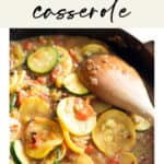 A pan of tex-mex squash casserole with a wooden spoon in the pan/