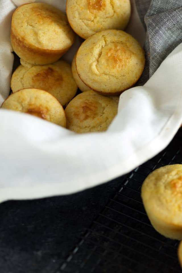 Spoon Bread Muffins with a linen napkin in a basket