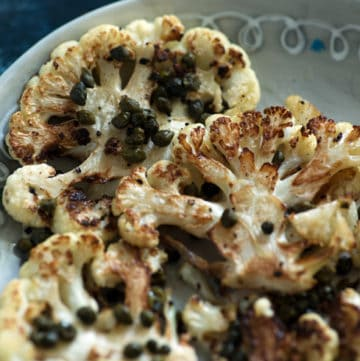 Roasted Cauliflower Steaks with Crisped Capers on plate