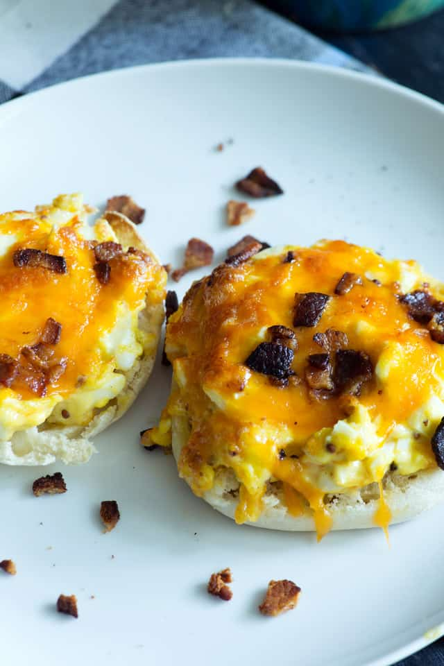 English Muffin Melts are great for breakfast when you have a crowd. Egg salad on top of an English muffin toasted with gooey cheese and sprinkled with bacon. |butterandbaggage.com