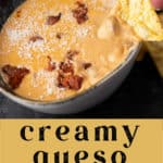 Creamy Queso with Chorizo with a chip being dipped in it.