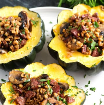 A platter of Farro and Sausage Stuffed Acorn Squash