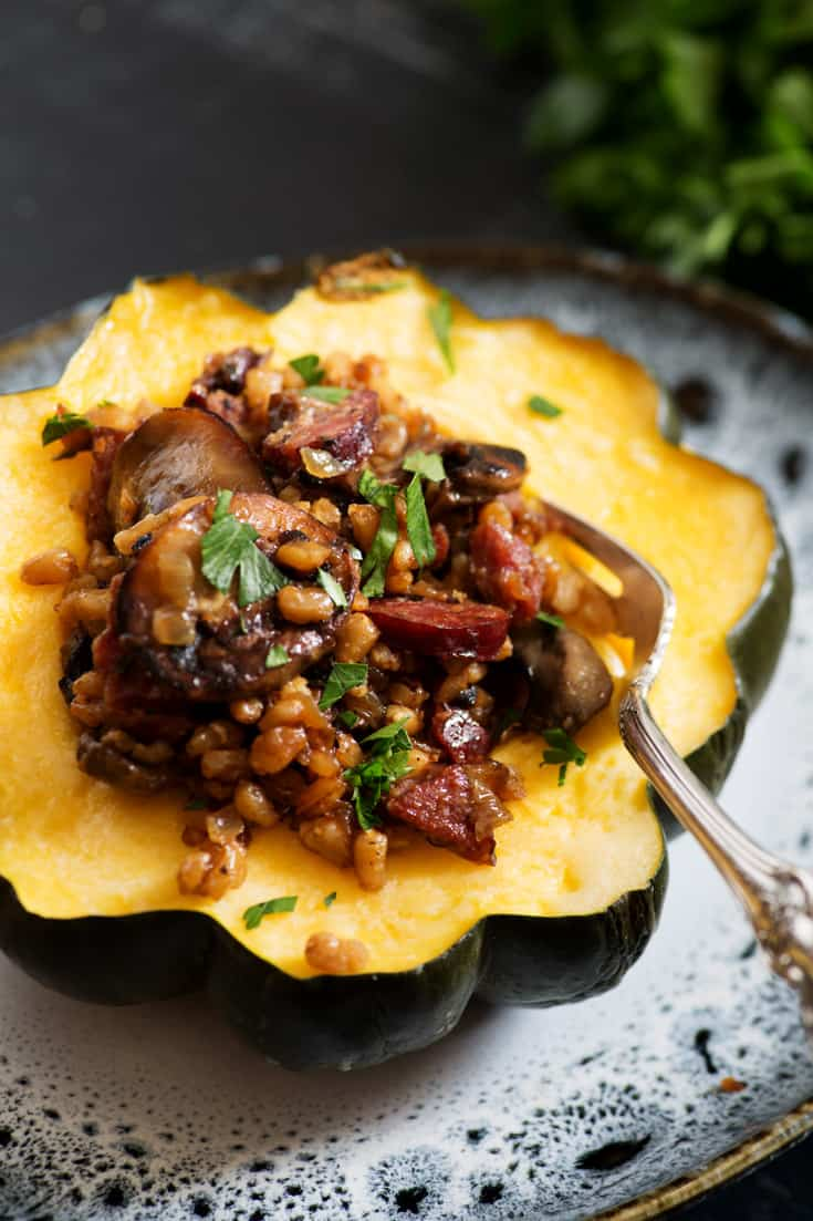 A serving of Farro and Sausage Stuffed Acorn Squash