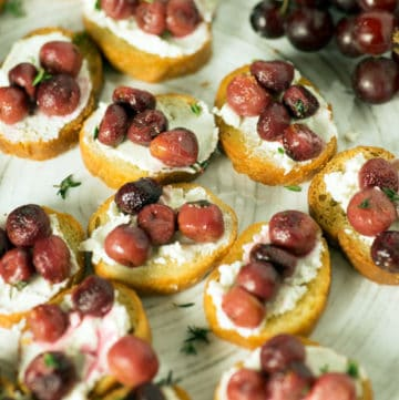 Roasted grapes and cheese on a baguette