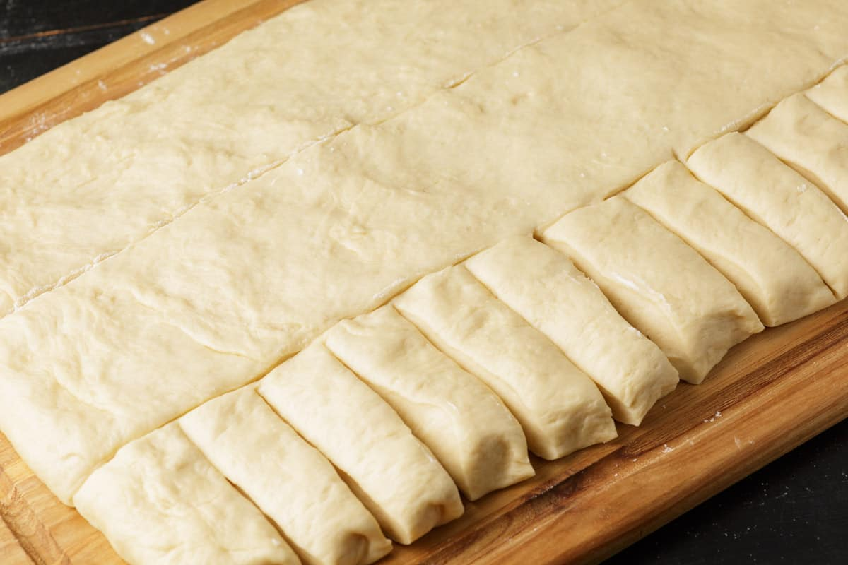 Yeast roll cut into strips to form into rolls.