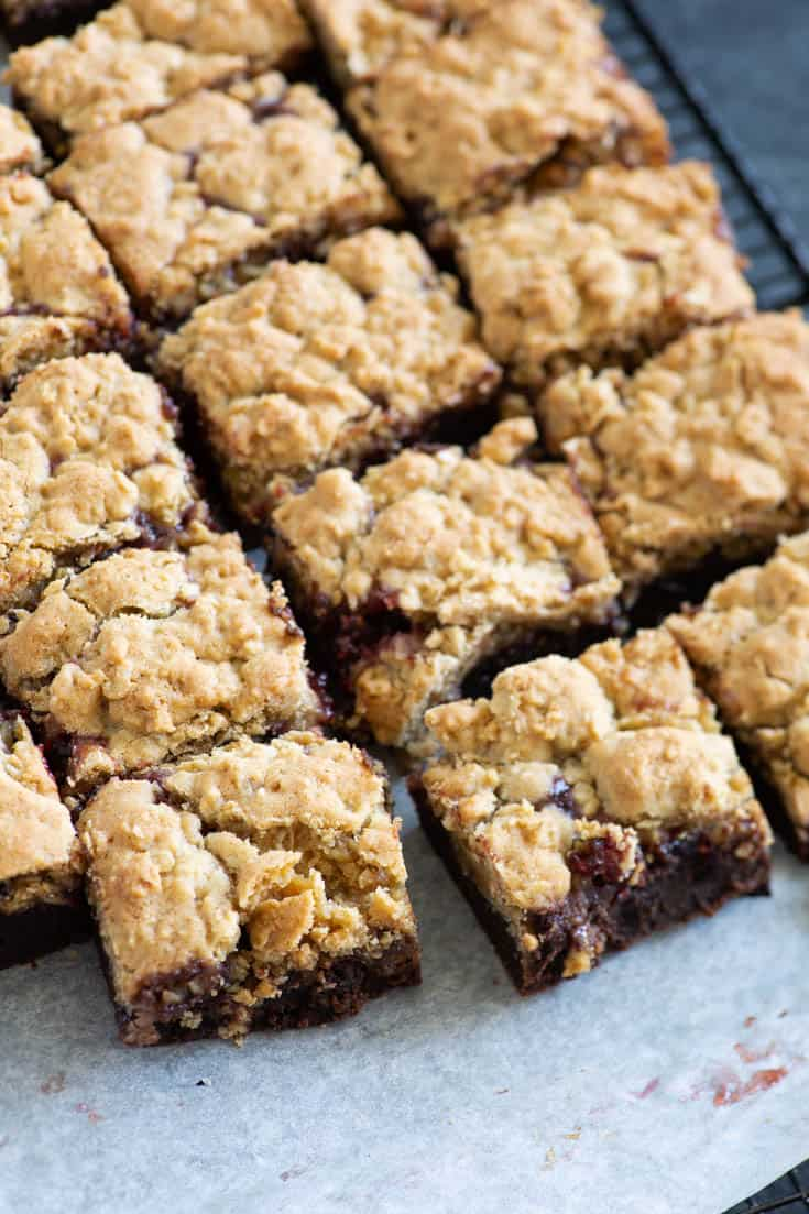 A pan of Raspberry Oatmeal Brownies on a cooling rack