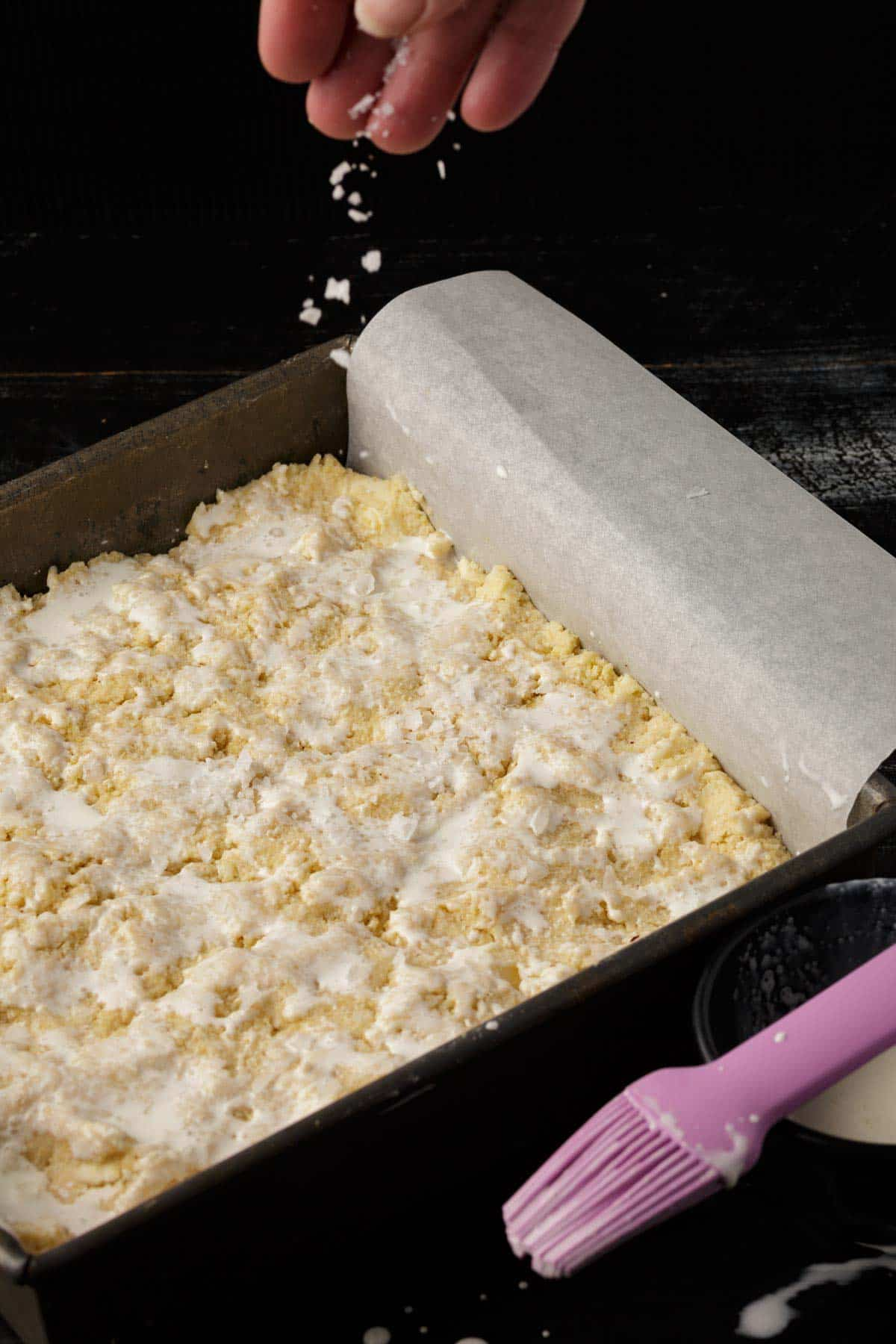Biscuit dough in a pan topped with cream
