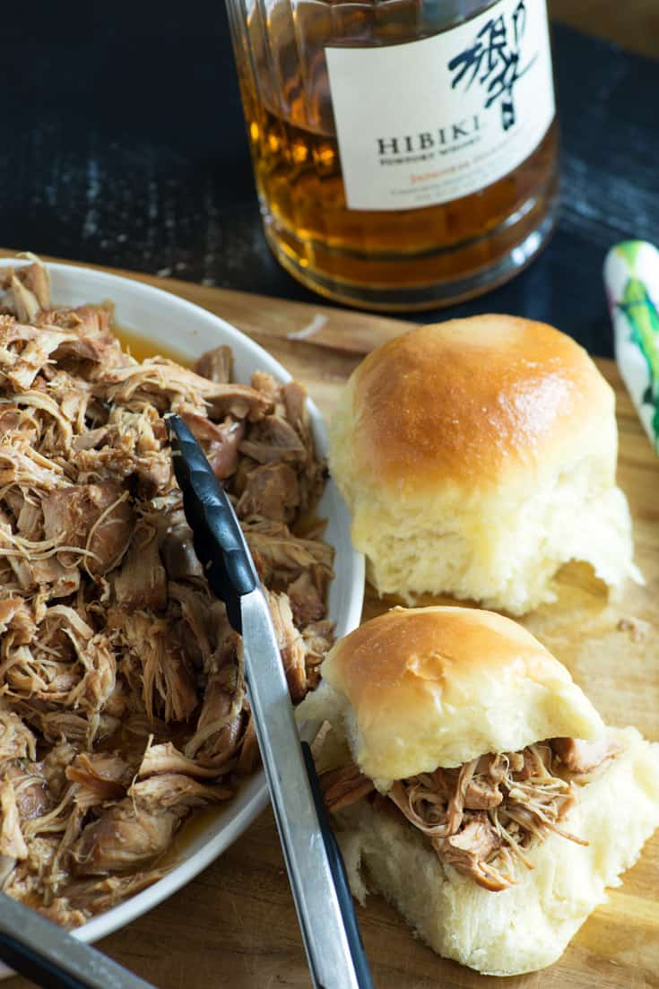 Slow Cooker Bourbon Pulled chicken on a platter