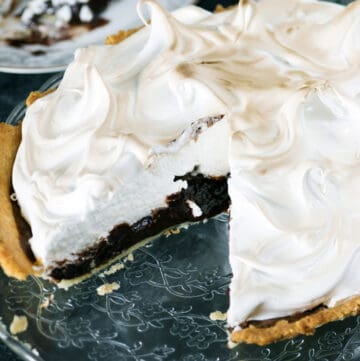 Decadent chocolate pie with a slice taken out.