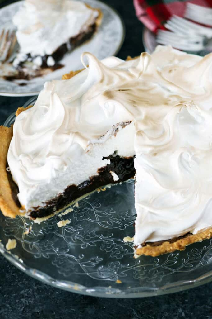 A chocolate pie with a slice missing.