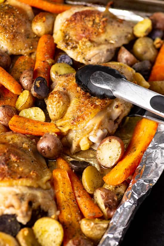 A sheet pan with chicken thighs