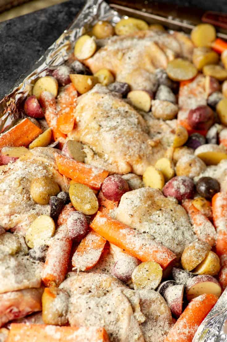 A pan of Ranch Chicken with Carrots and Potatoes before it has been baked