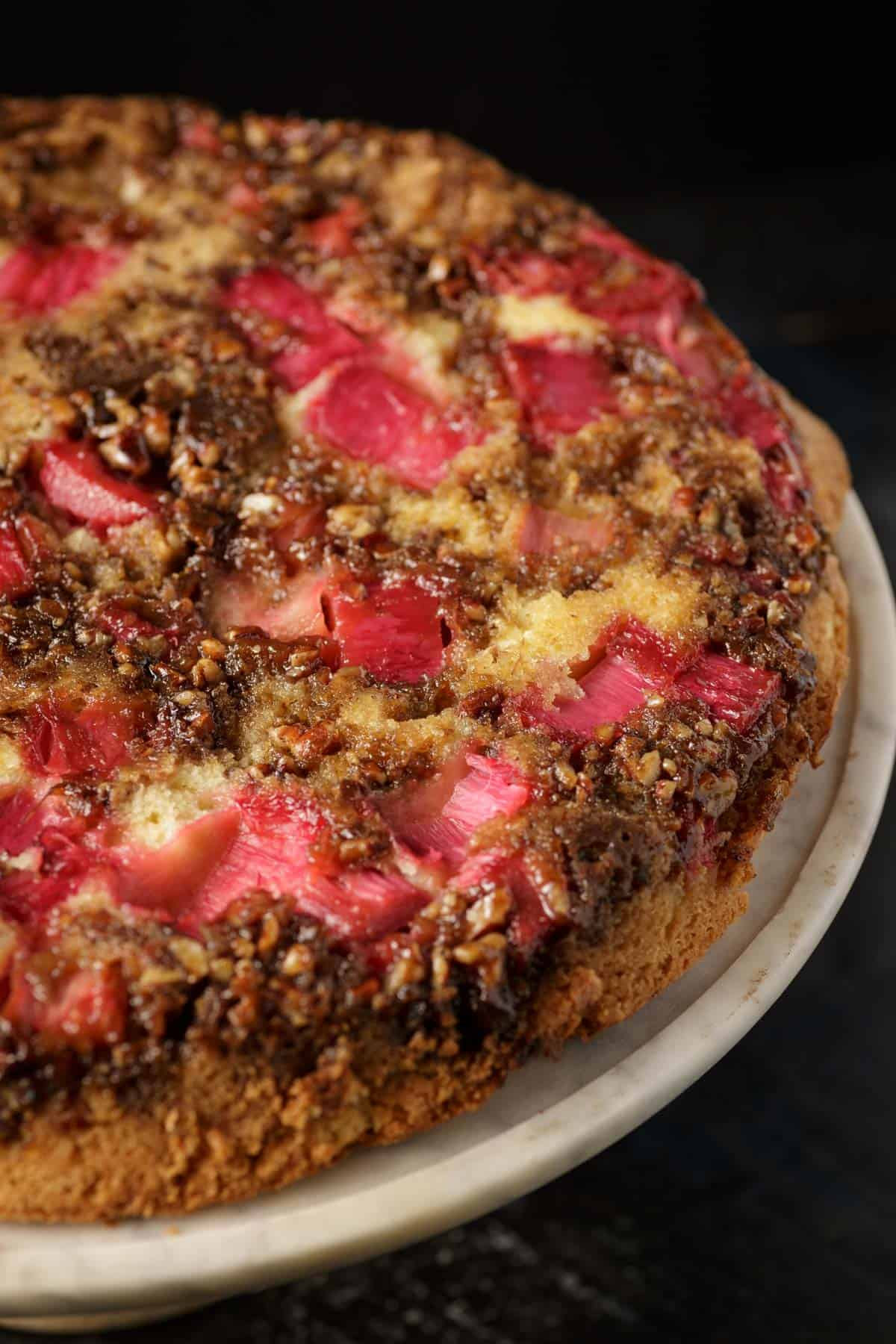 A rhubarb cake after it has been flipped onto a serving paltter