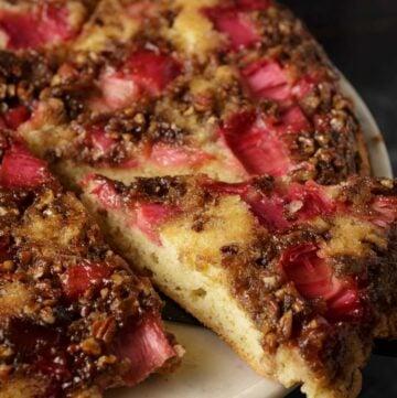A slice of rhubarb cake on a cake platter