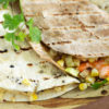 Two grilled quesadillas with shrimp and corn