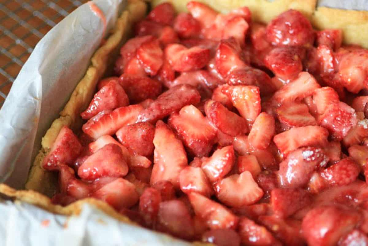 Fresh strawberries in a crust in a square pan