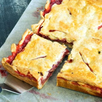 A corner of a strawberry slab pie