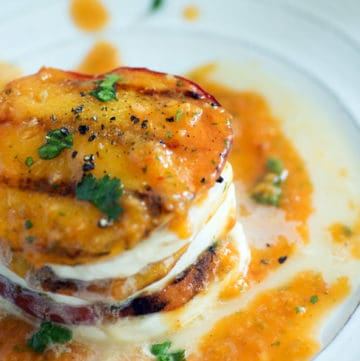 A stack of grilled peaches and mozzarella