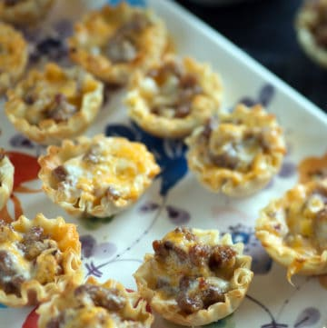 Sausage cups on a platter