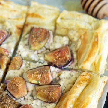 A Goat Cheese and Fig Tart on a baking sheet