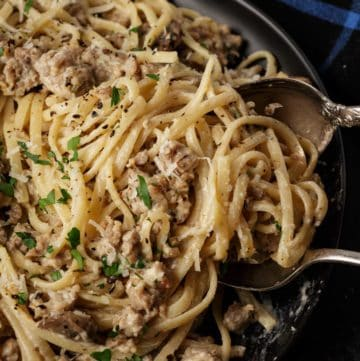 Creamy pasta with Italian sausage on a platter