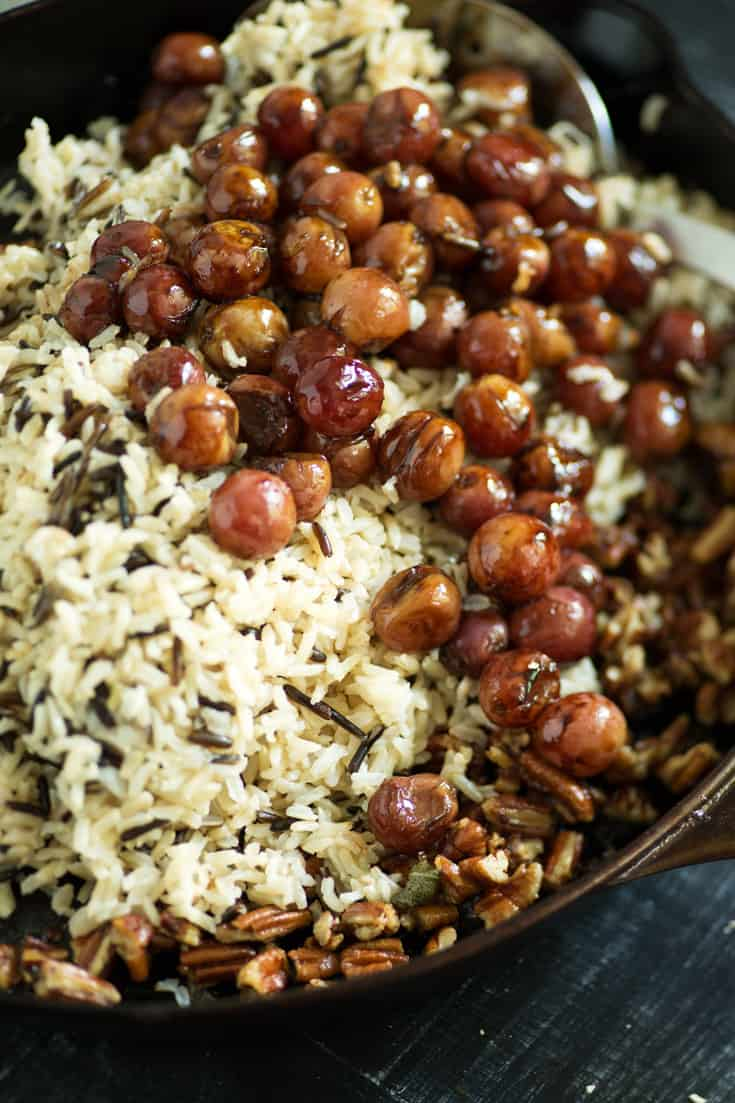 A skillet of the ingredients for Wild Rice and Roasted Grapes