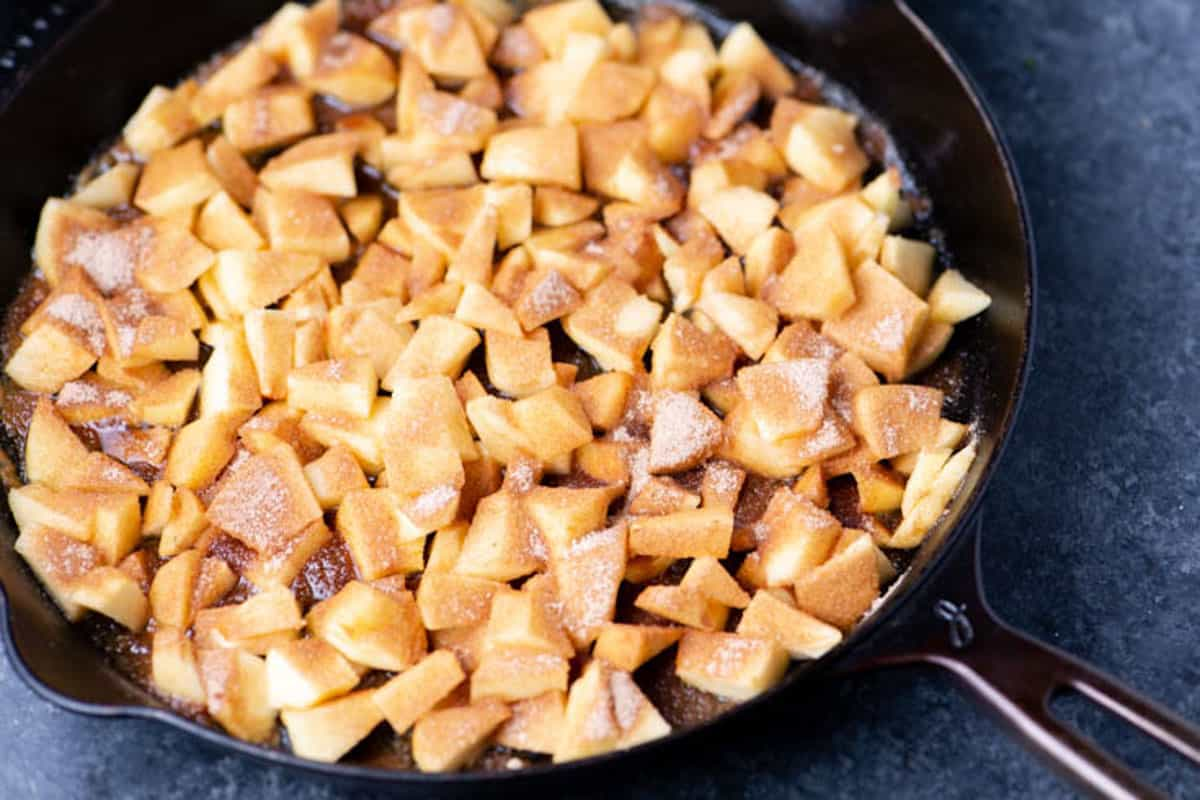A skillet of chopped apples.
