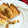 An Apple Fan Tan Cinnamon Roll on a plate